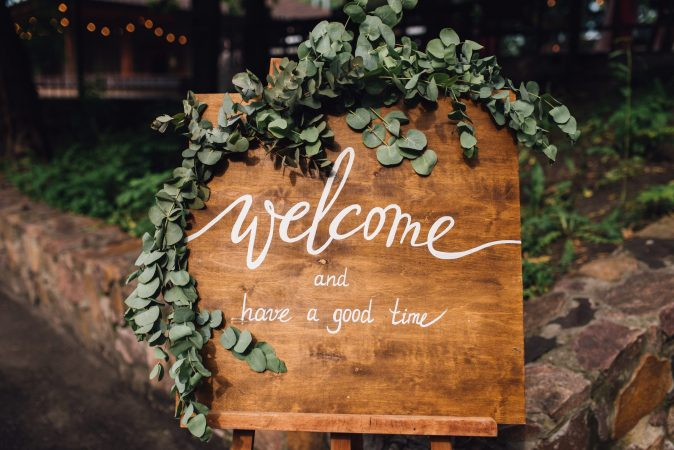 Handmade,Wooden,Board,With,Welcome,Sign,On,It,Decorated,With